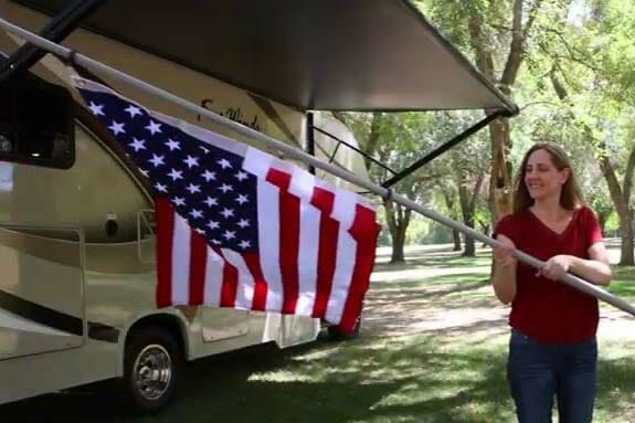USA Flag on Flag Pole in front of an RV