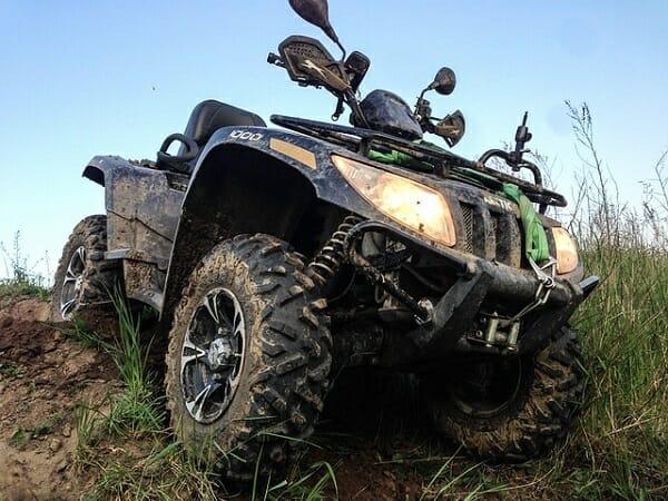 muddy tires on an atv