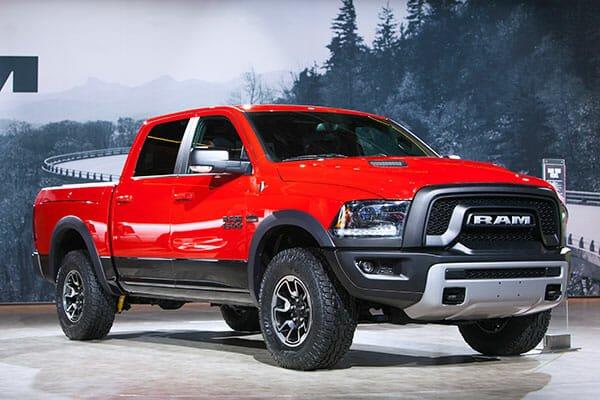 Dodge fender flares on a red Ram