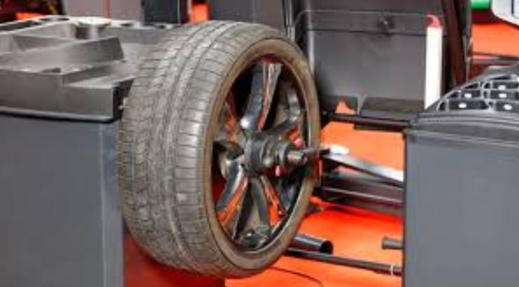 What are the symptoms of a wheel out of balance
